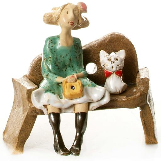 Ceramic Lady Figurine sitting on Bench with White Westie