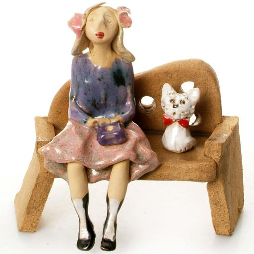 Ceramic Lady Figurine with 1 Dog Sitting on Bench in Pink Dress | White Westie
