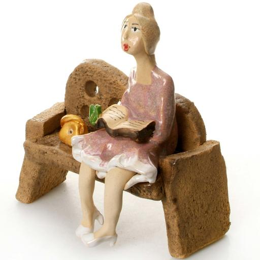 Ceramic Lady Figurine in Pink sitting on Bench with Breen Bird
