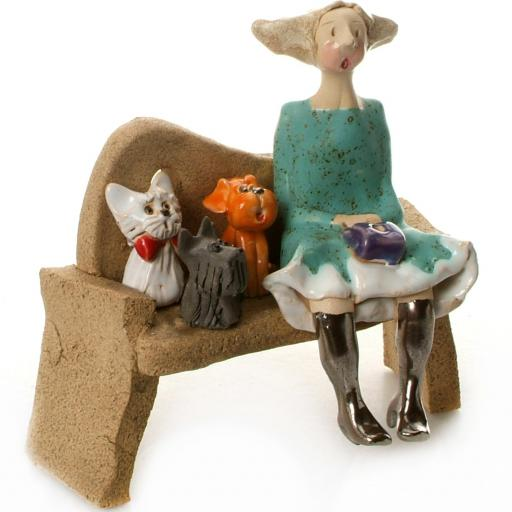 Ceramic Lady Figurine Sitting on Bench in Turquoise Dress | Brown Shih Tzu